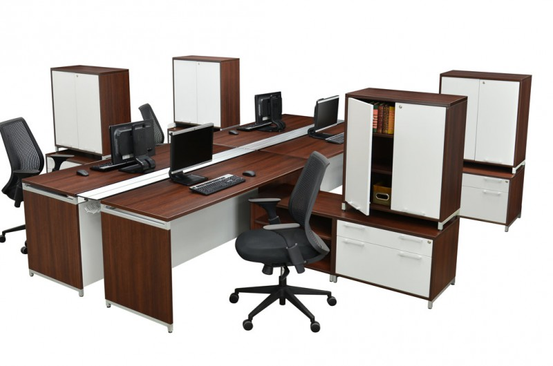 OneDesk Collection 4 pod desk setup with low credenzas and storage towers.